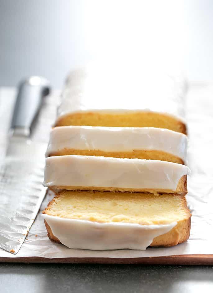 Image of baked, iced, and sliced gluten free lemon pound cake.