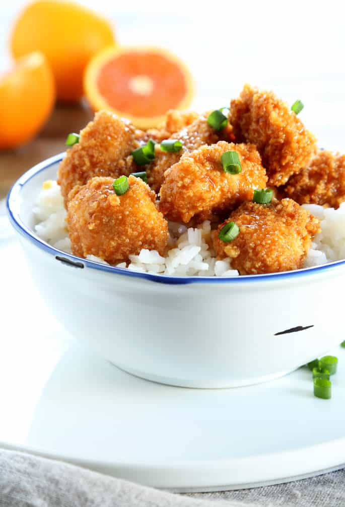 Chinese-style orange chicken with rice in a white bowl