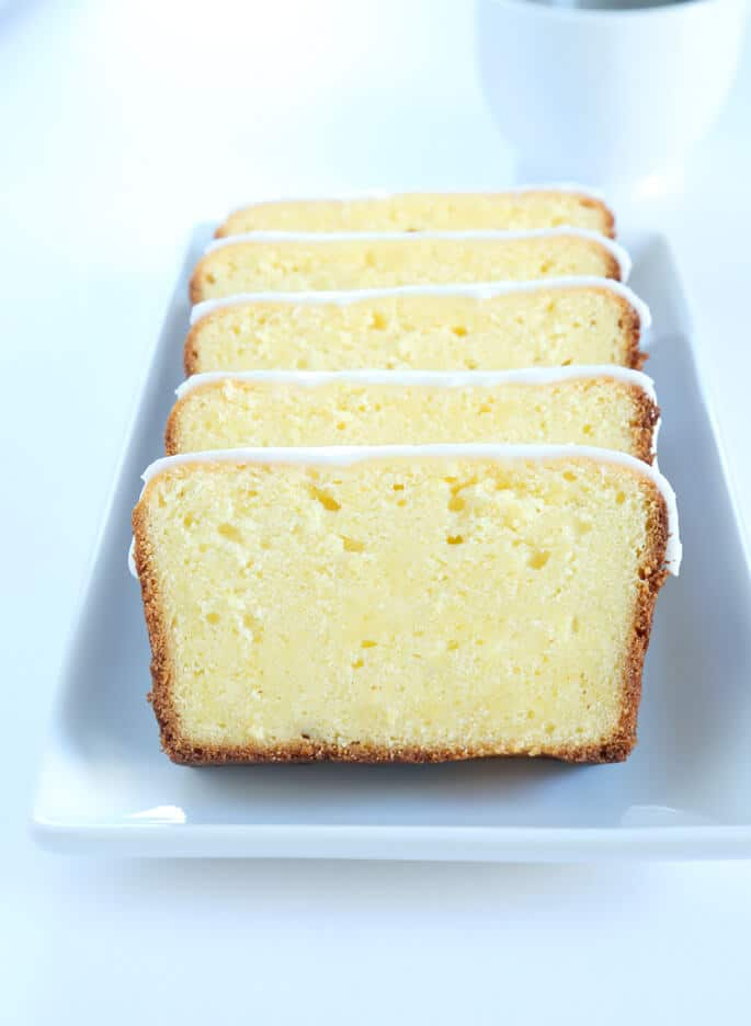 This gluten free iced lemon pound cake is a moist and tender, sweet pound cake is just like those thick slices of lemon pound cake that stare back at you in the glass case at Starbucks.