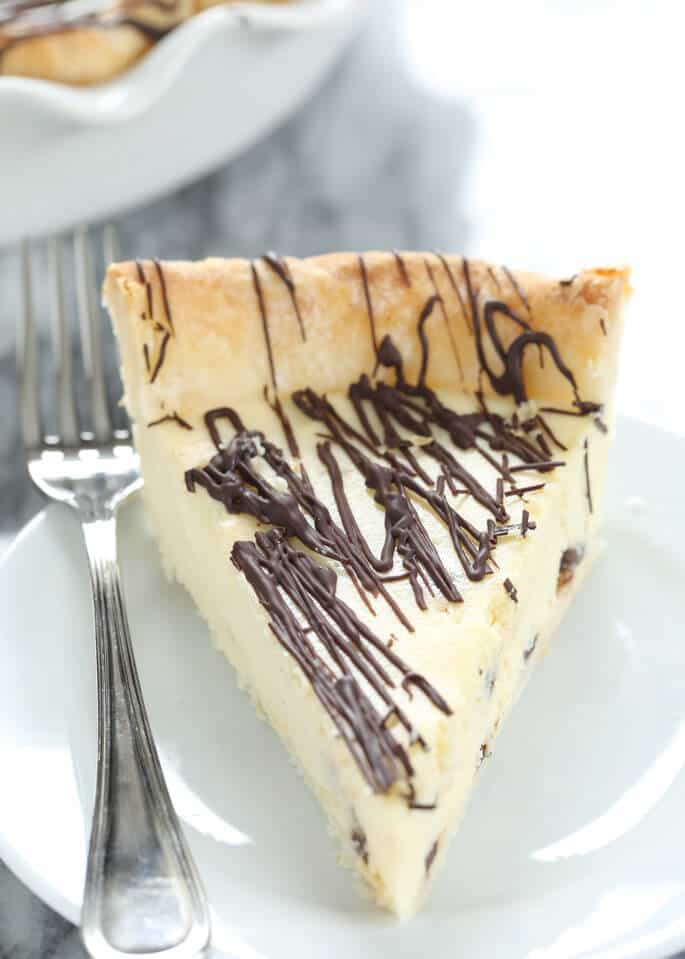 A close up of cannoli pie on white plate