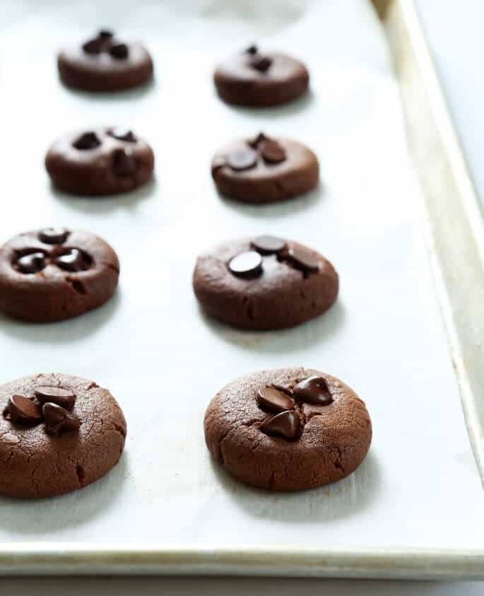 A tray with chocolate flourless peanut butter cookies on it