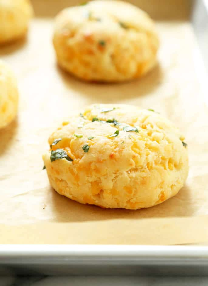 A closeup of one gluten free cheddar bay biscuit on a tray