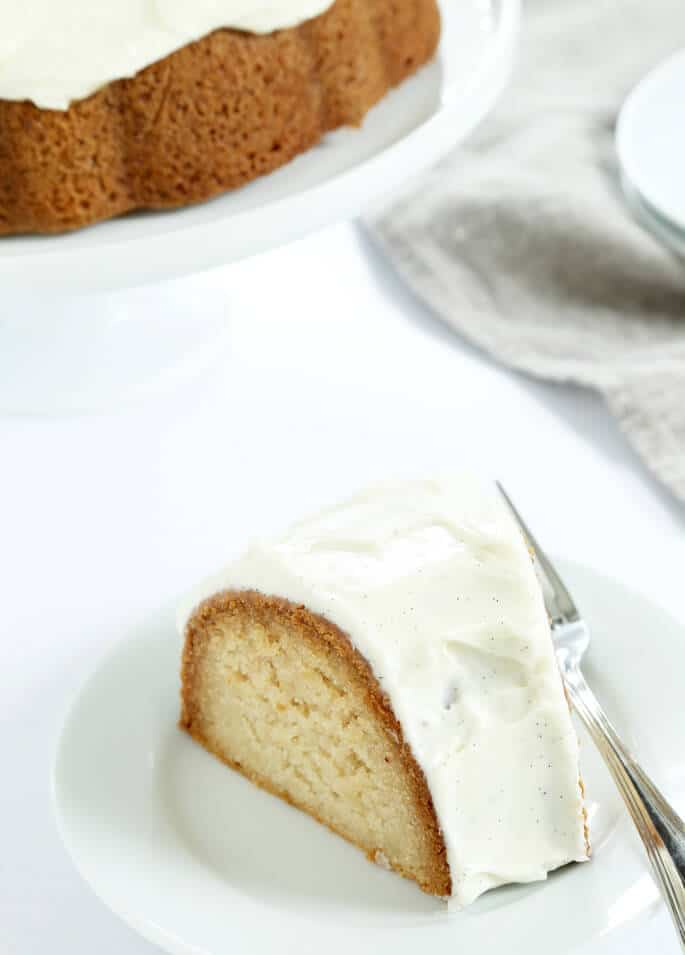 A piece of vanilla crazy cake on a white plate