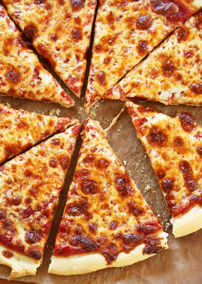 Close up of pizza on brown surface
