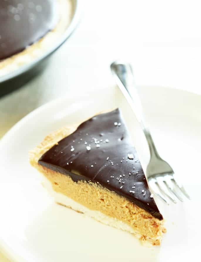 Close up of a slice of peanut butter pie on white plate with fork