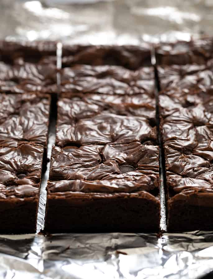 An image of just sliced flourless brownies.