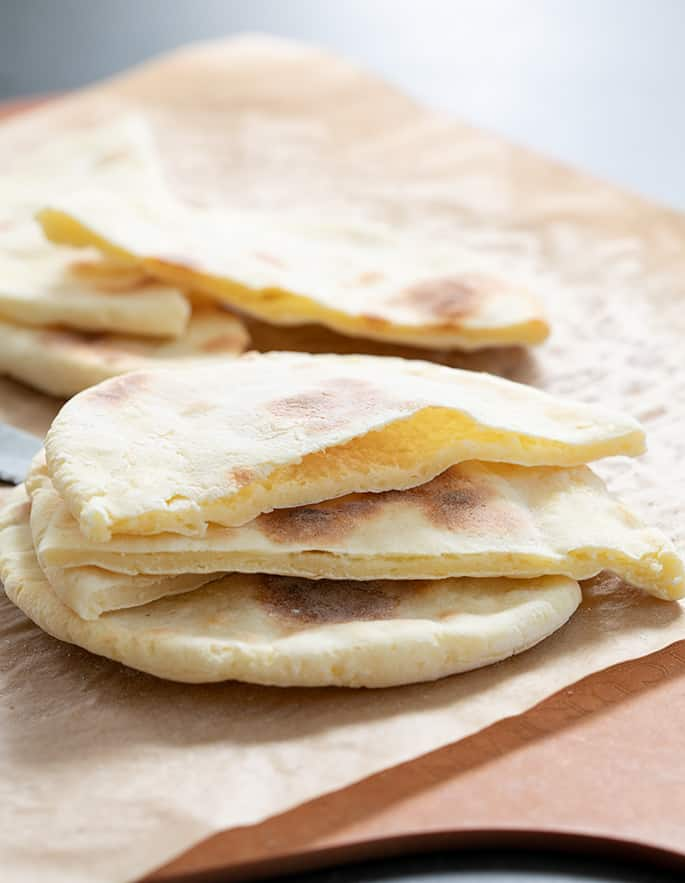 Yeast free gluten free pita breads just out of the oven, sliced open.