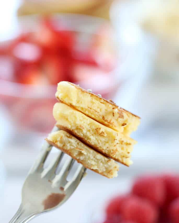 A fork with three pieces of coconut flour pancakes