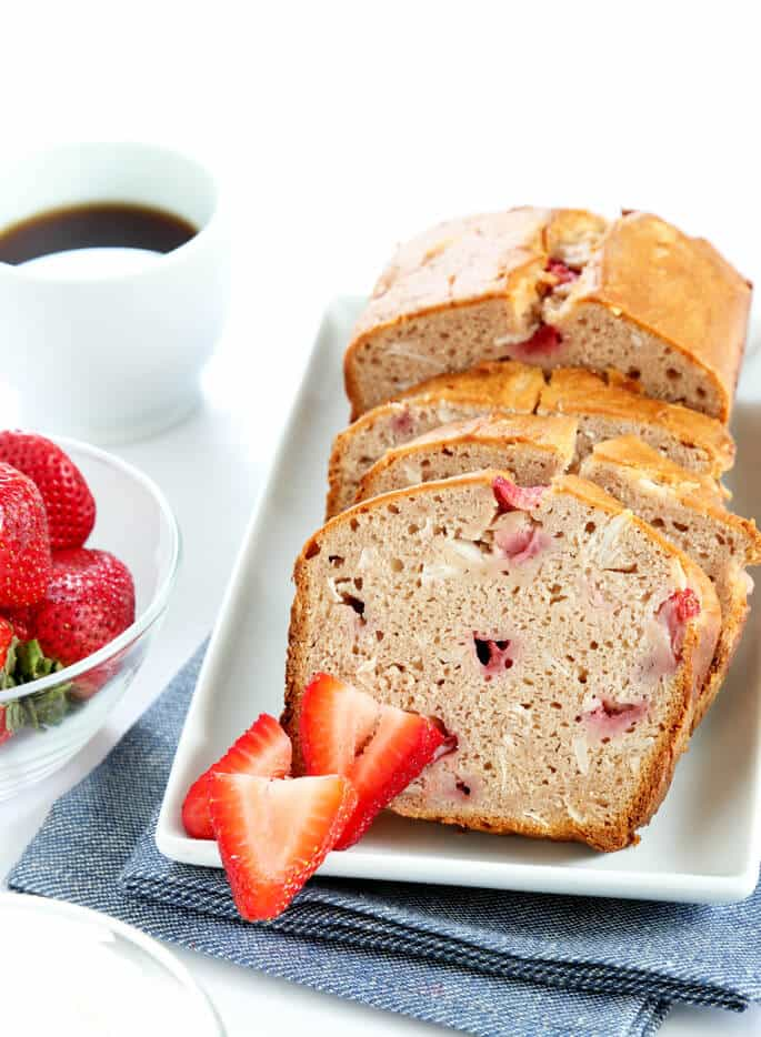 A loaf of strawberry bread on a white plate