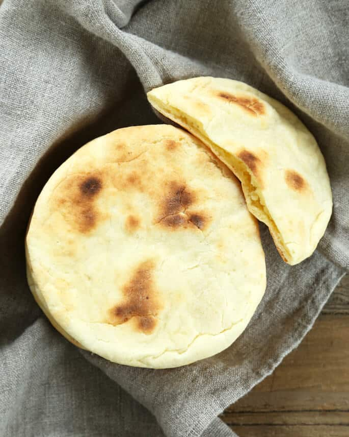 Overhead view of pita bread on a gray towel