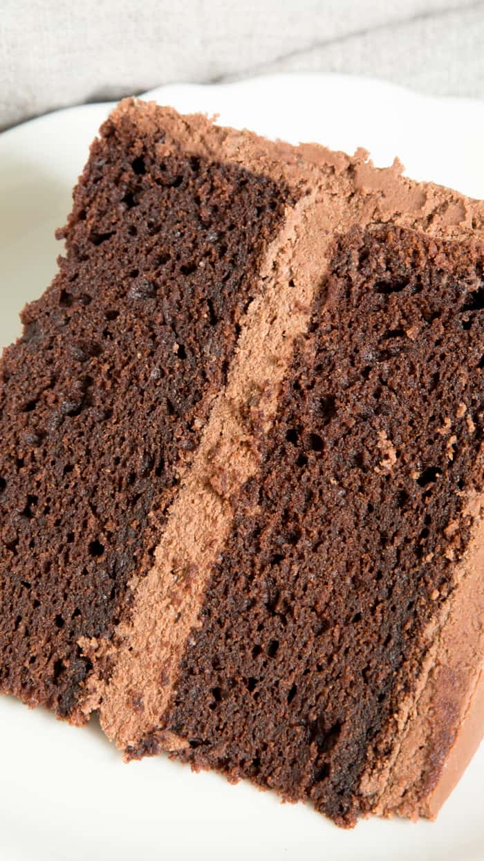 This easy gluten free chocolate cake is rich, dense and fudgy, and it's all made in just one bowl. Make a double layer or single, with the simplest chocolate ganache frosting. Say hello to your new favorite chocolate cake recipe! https://glutenfreeonashoestring.com/one-bowl-gluten-free-chocolate-cake/