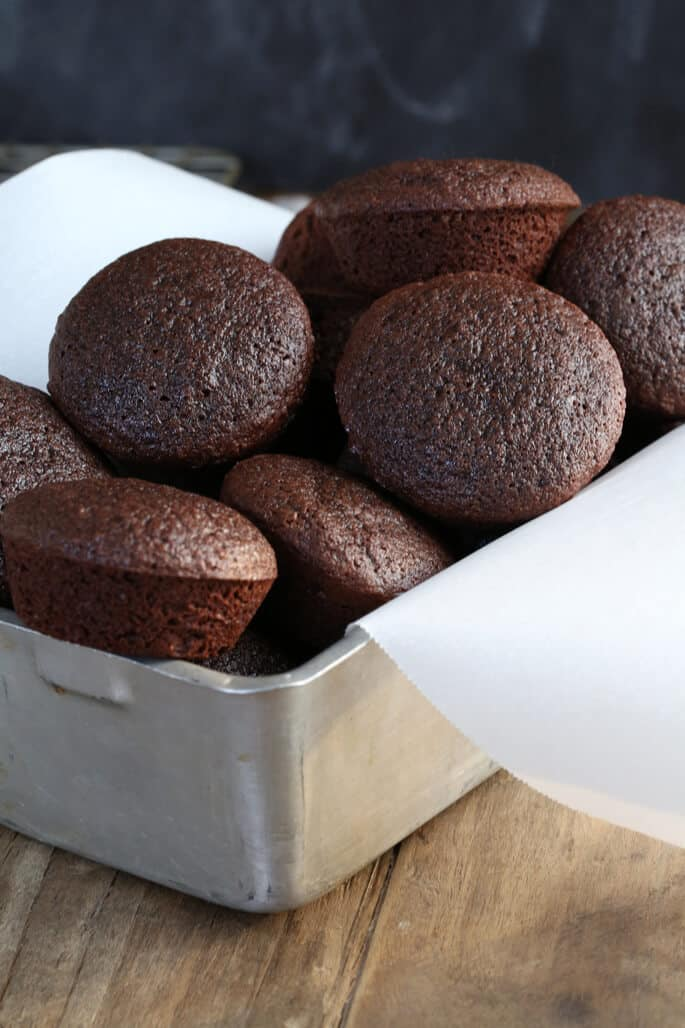 Gluten free two bite brownies are the perfect mix of decadent brownie and rich chocolate cake. Just like the kind in the tub—but these are gluten free!