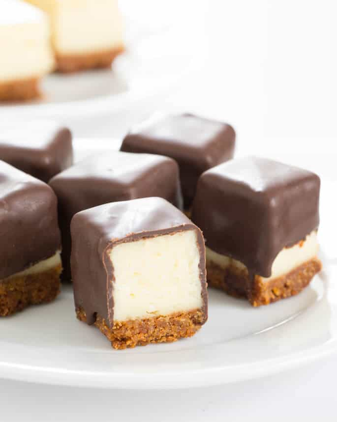 Cheesecake bites are nothing more than little chocolate-covered morsels of creamy cheesecake. No special equipment and no water bath needed, since chocolate covers any cracks. One-bite perfection!