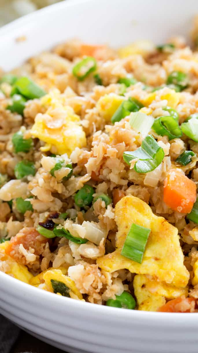 Tastycauliflower fried rice is the low carb, Paleorecipe that satisfies your craving for takeout. Learn to make riced cauliflowerthe easy way with frozen, defrosted cauliflower. https://glutenfreeonashoestring.com/