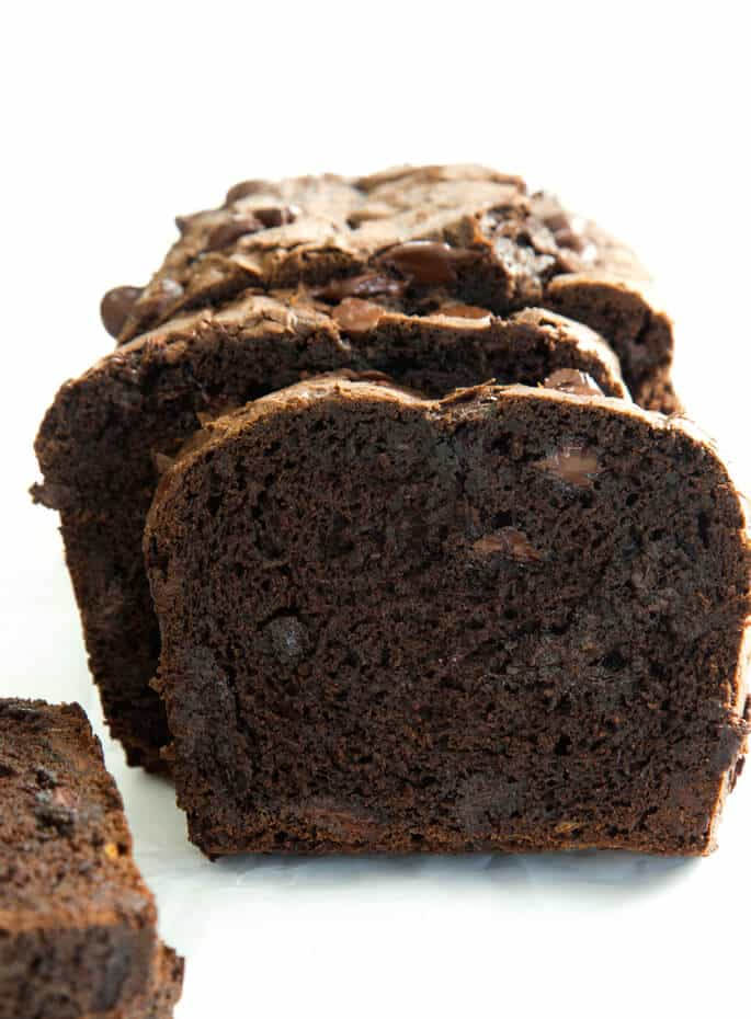 Close top of chocolate zucchini bread on a white surface
