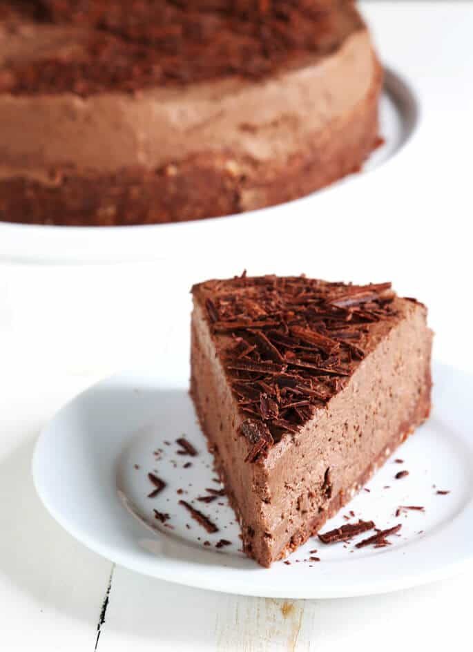 A light and fluffy, mousse-like no bake gluten free chocolate cheesecake that isn't too rich or too sweet—and can be made with or without a simple cookie crumb crust. Make it tonight, just because!