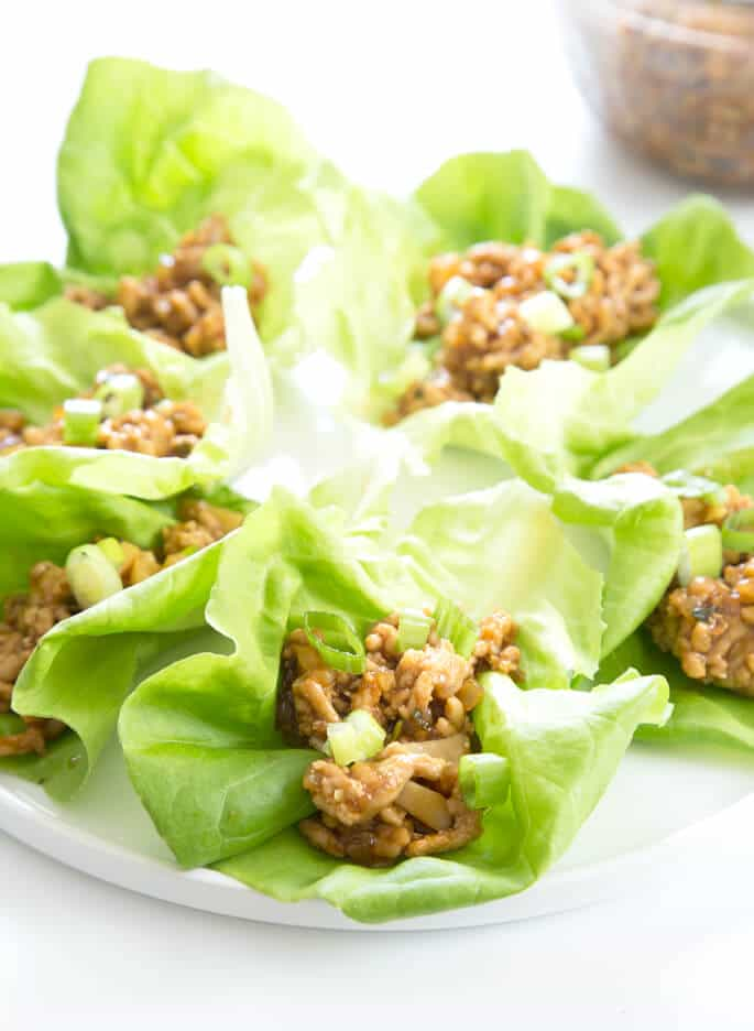 This easy recipe for Asian chicken lettuce wraps is made with sesame oil, soy sauce, garlic, rice vinegar and wine, and just a touch of honey. A family favorite in my house!