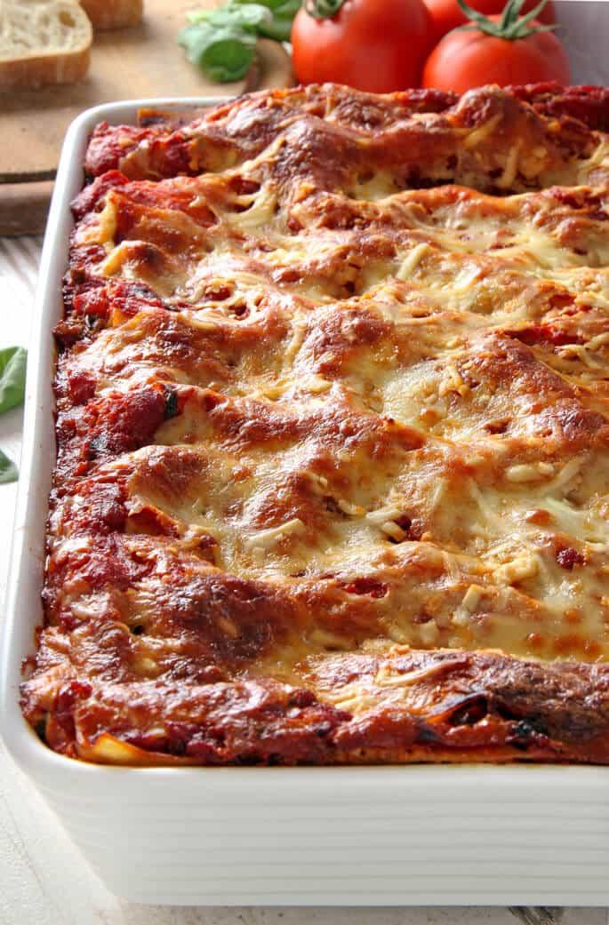 An overhead view of lasagna in a metal pan