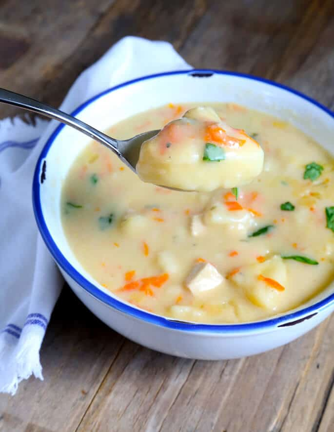 This simple recipe for gluten free chicken and dumplings is so easy, with make-ahead biscuits and make-ahead cream of chicken soup. It's also amazing with leftover holiday ham. Make it tonight!