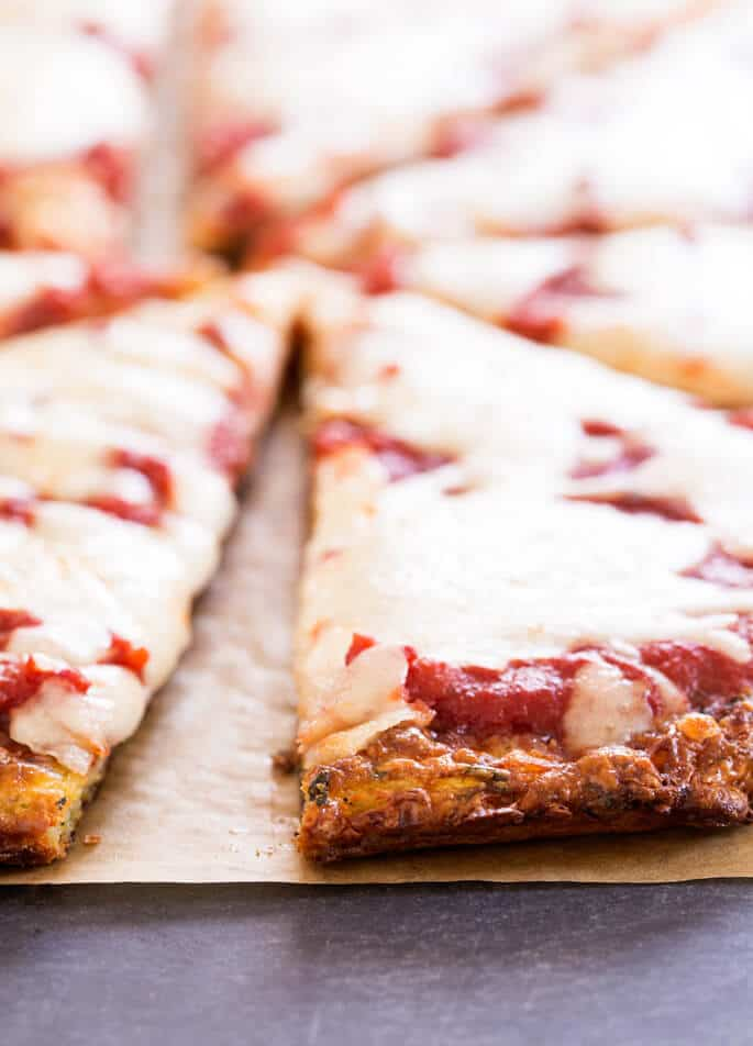 Closeup of crust of zucchini pizza slices