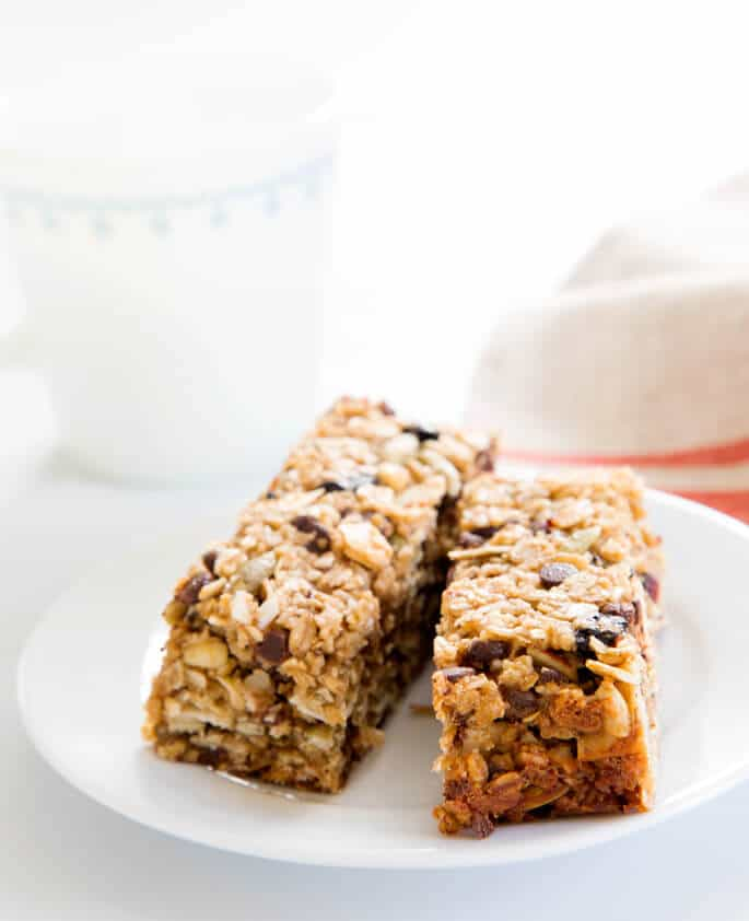 A close up of 2 granola bars on a white plate