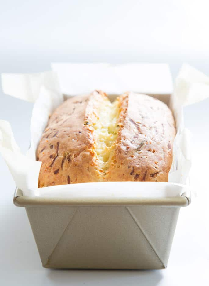 A close up of zucchini bread in metal loaf pan