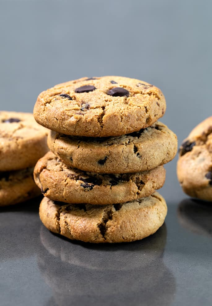 Stack of Paleo chocolate chip cookies on black table