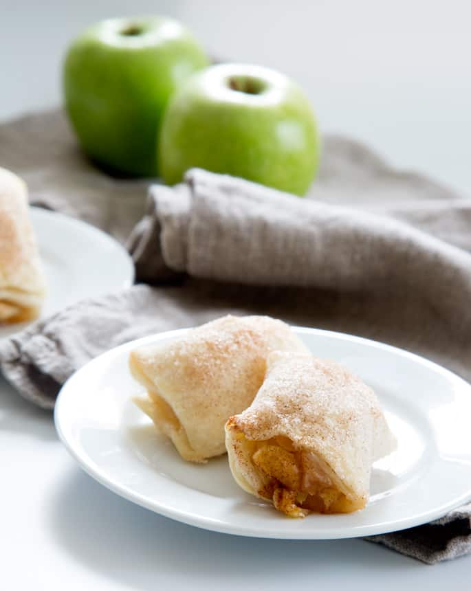 Easy gluten free apple dumplings, baked in a simple pie crust, have all the taste and aroma of apple pie without all the fuss. Apple season is the most wonderful time of the year!