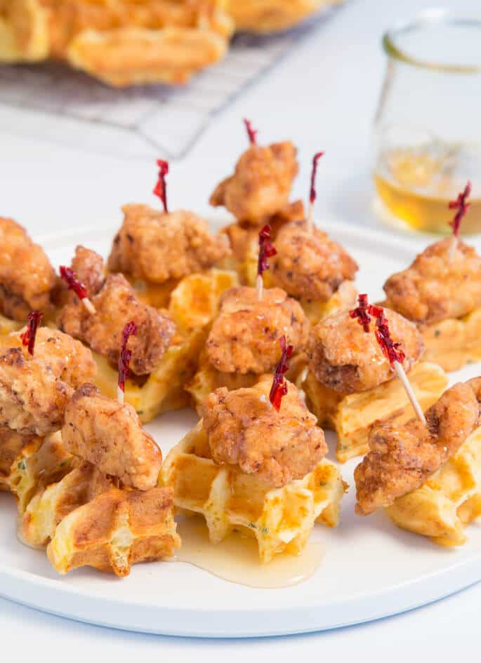 Savory waffles made with cheddar cheese and chives, plus crisp bites of lightly spiced fried chicken make this the perfect small bite!