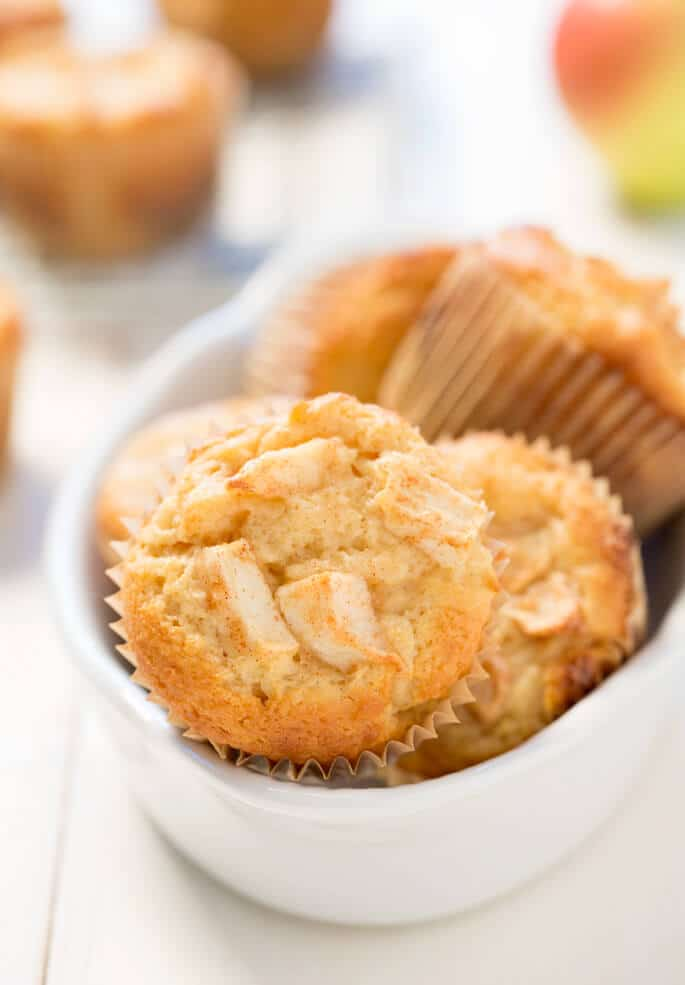 The easiest recipe for perfectly spiced gluten free apple muffins you'll ever find, with plenty of diced apples inside, made extra tender with sour cream in the batter. Long live apple season!