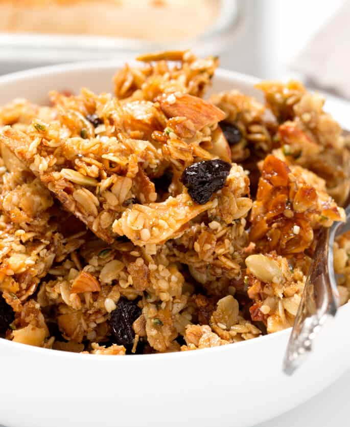 Close up of maple almond granola in a white bowl