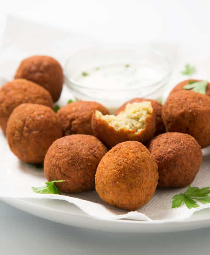 Authentic gluten free falafel, made with soaked raw chickpeas and just the right herbs and spices. The ultimate Middle Eastern street food, made gluten free!