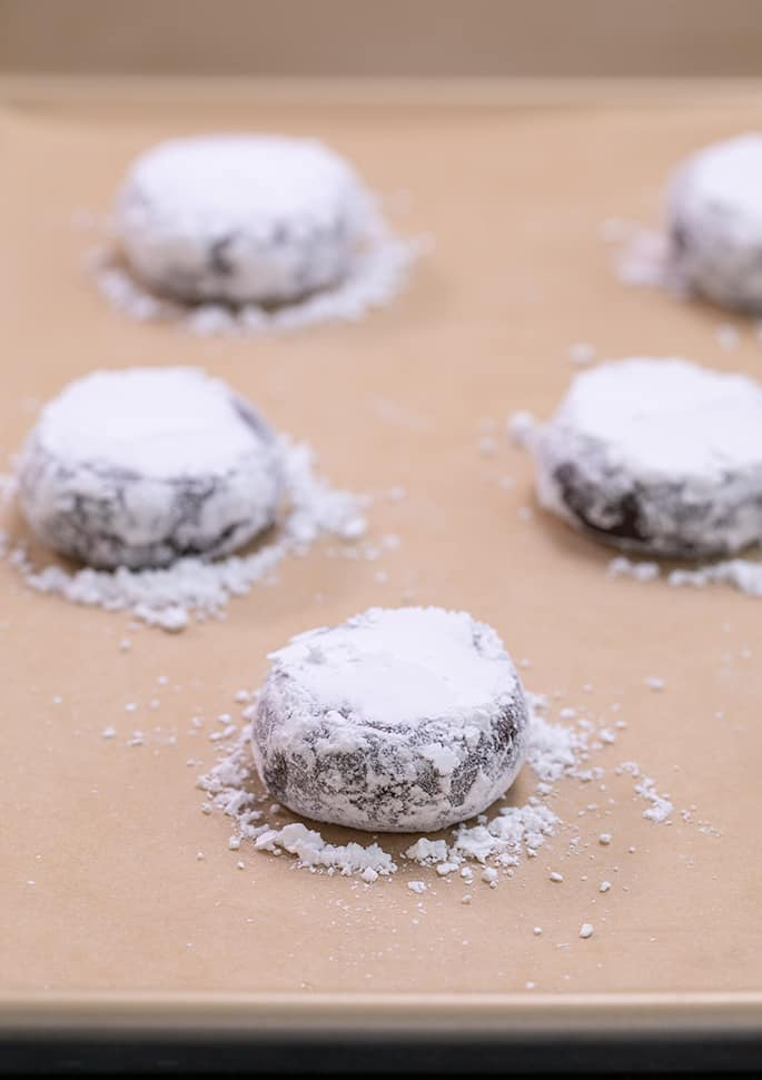 Chocolate crinkle cookie dough shaped with confectioners' sugar