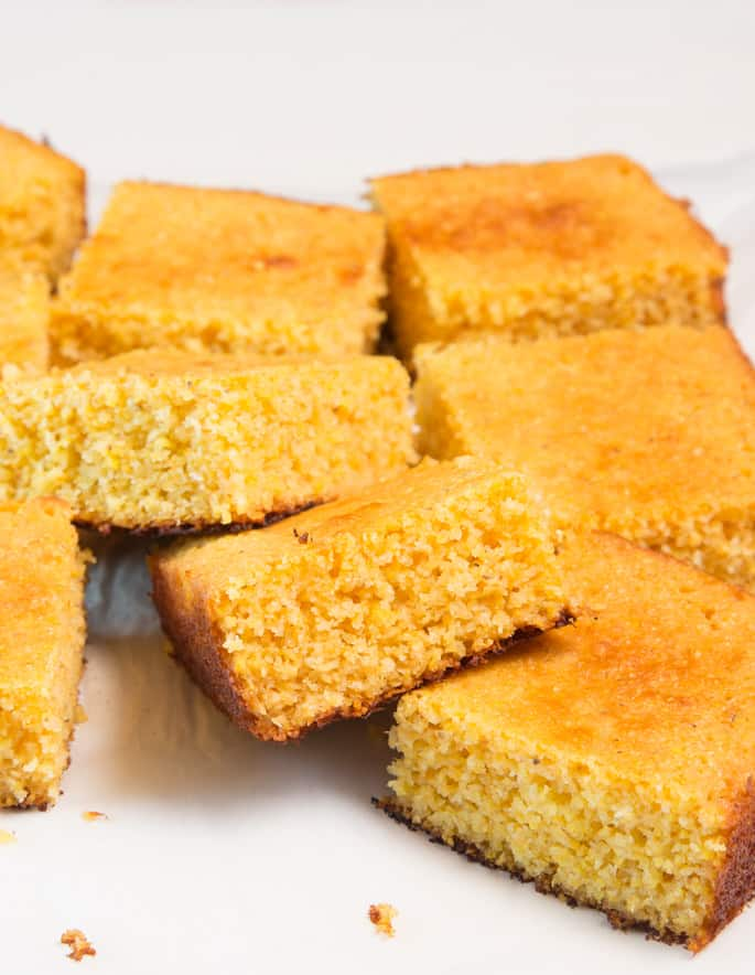 8 pieces of cornbread on a white surface