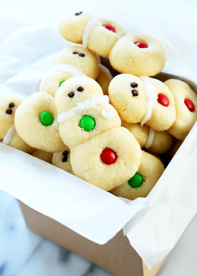 Every box of holiday cookies needs a star. These gluten free snowman sugar cookies are the flashy cookies to put at the top of the box. And no one has to know just how easy they are to make!