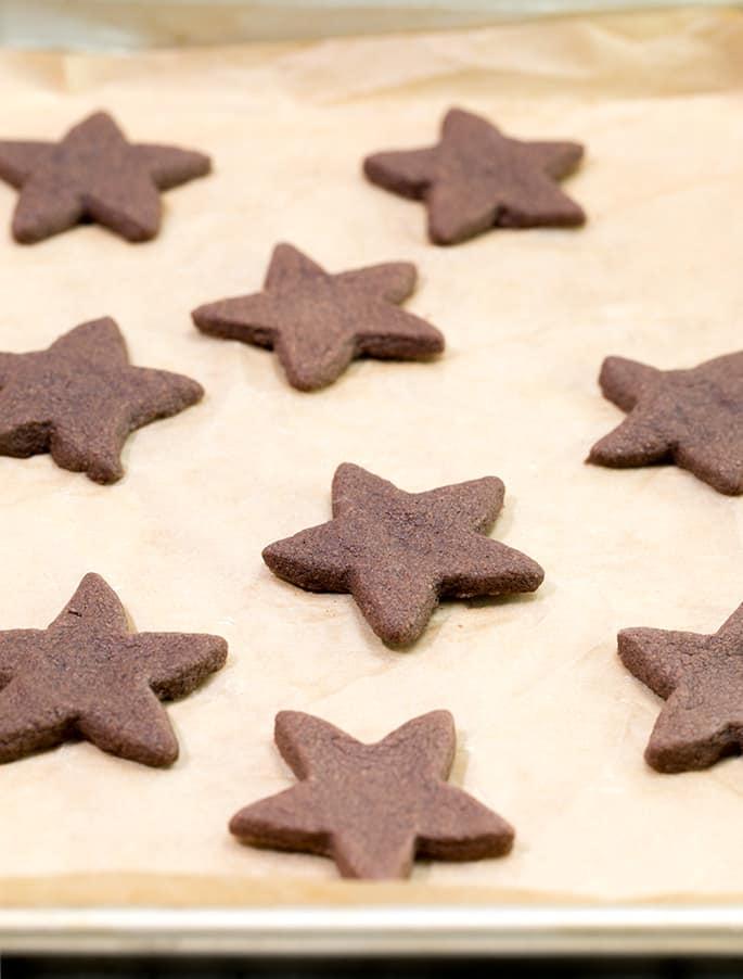 Chocolate shortbread cookies on beige sheet