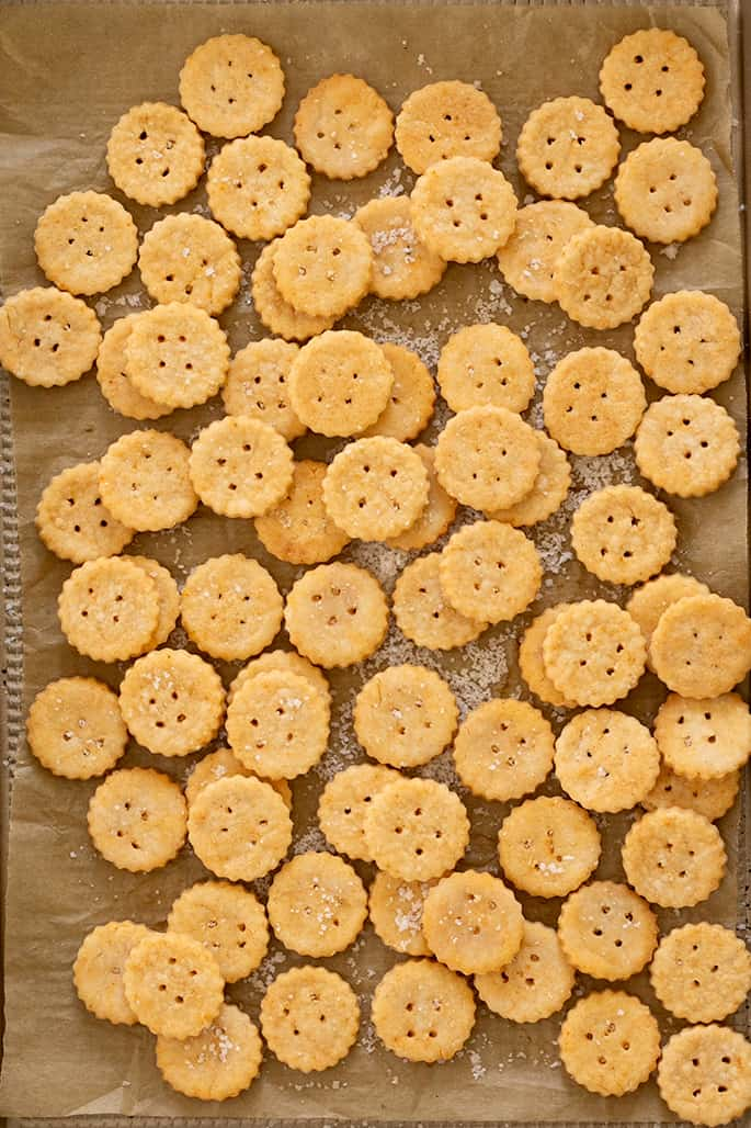 Baked Ritz crackers piled on baking tray overhead image