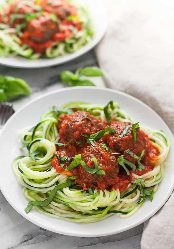 These paleo meatballs are tender, flavorful, and super satisfying on top of a bed of spiralized zucchini noodles!