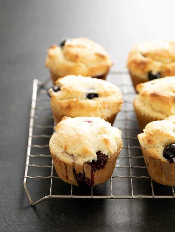 Gluten free blueberry muffins bakery pictured on a wire cooling rack