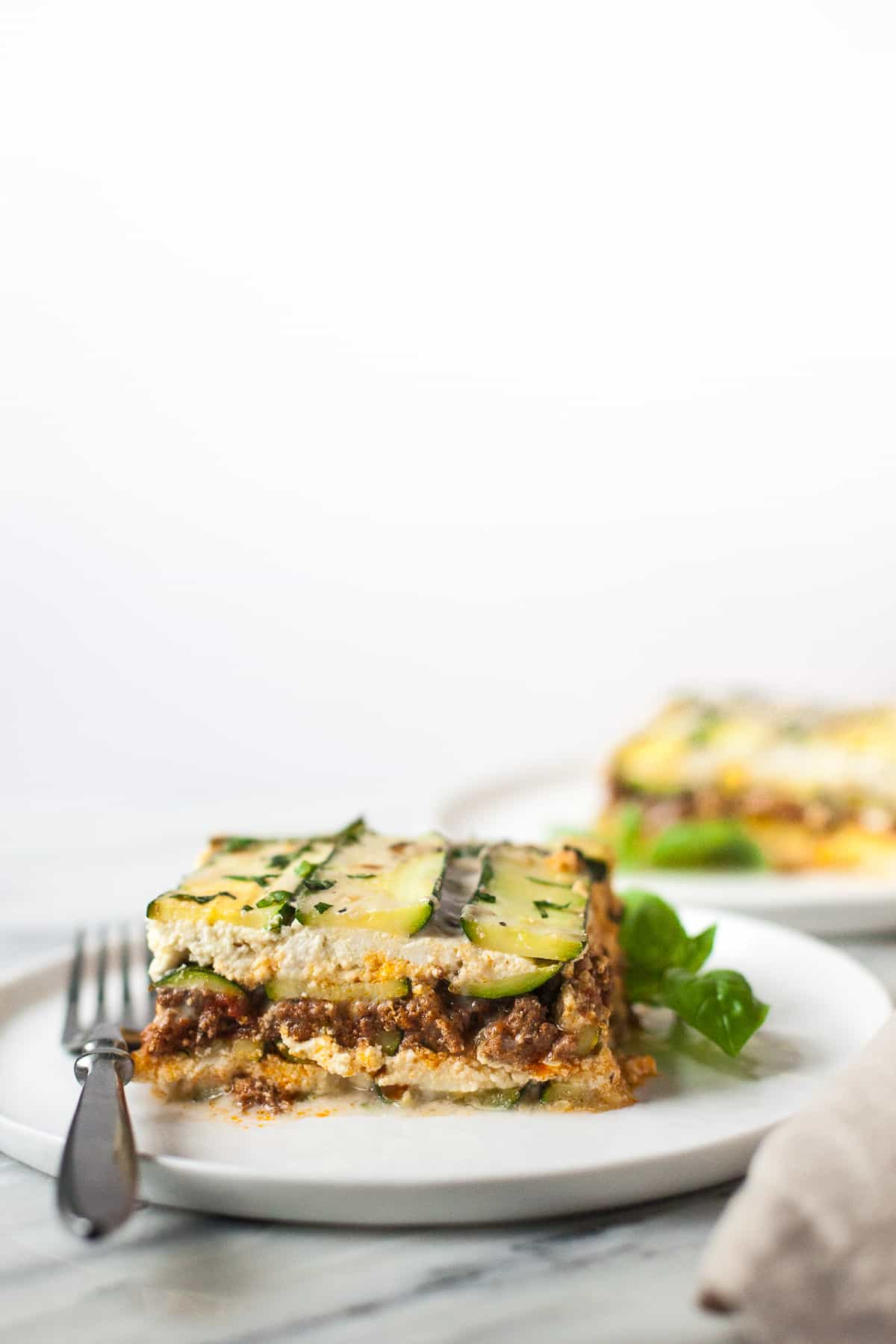 Craving Italian comfort food but avoiding grains and cheese? This Paleo zucchini lasagna is for you.