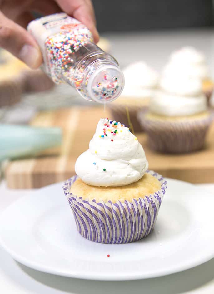 These never-fail bakery-style gluten free vanilla cupcakes are incredibly moist and tender. They can even easily be made dairy free, too!