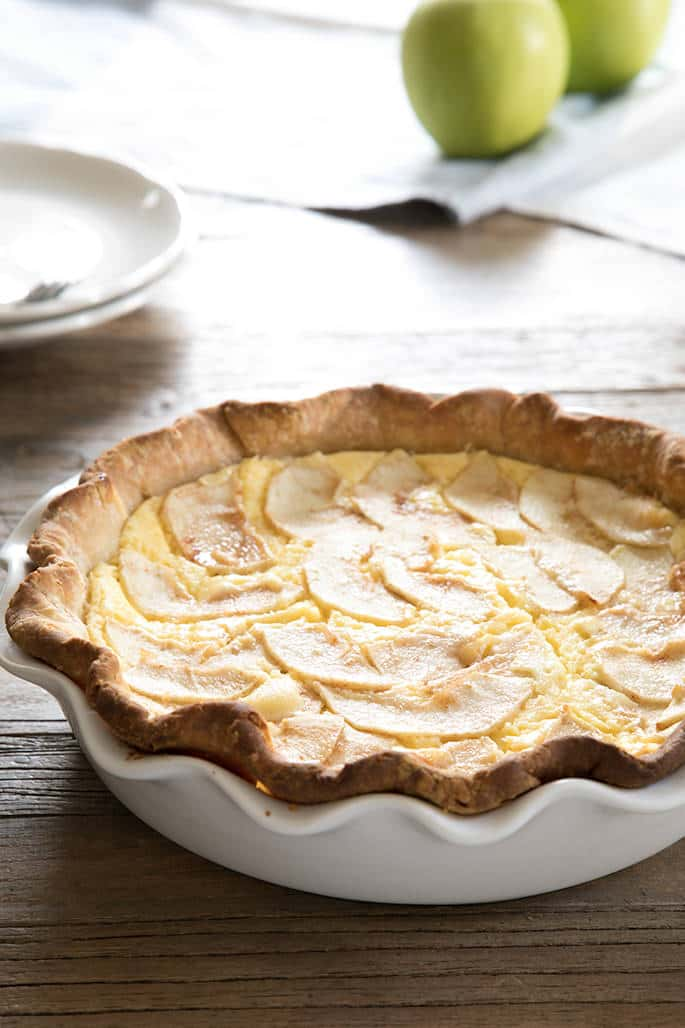 This traditional, lightly sweet egg custard pie with apples is made perfect for apple season with layers of thinly sliced apples. With or without a crust!