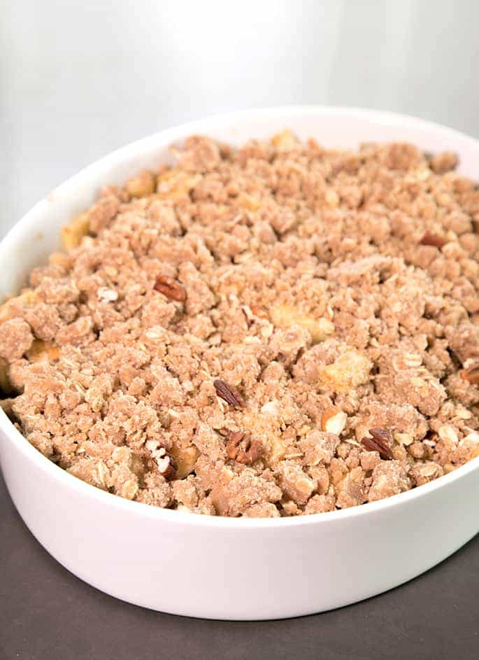 This gluten free apple crumble recipe is loaded with the season's best apples and topped with crisp chunks of apple spiced goodness. Make it with or without oats!