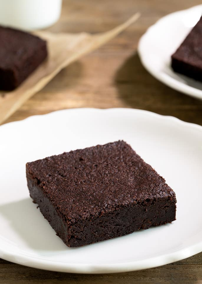 The richest fudgy gluten free brownies recipe made simply with a very basic rice flour blend, cocoa powder and melted dark chocolate. A chocolate lover's dream!