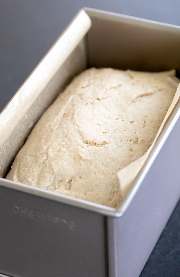 Raw gluten free brown bread dough in pullman pan