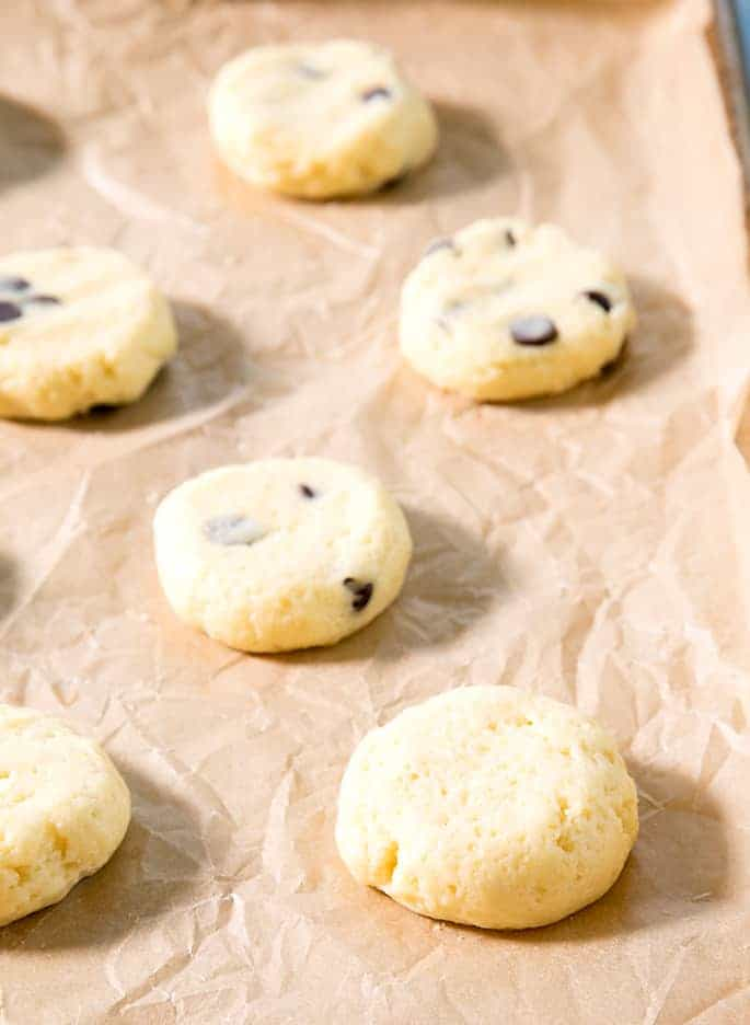 These soft and chewy cheesecake cookies are made by dressing up a vanilla cake mix with cream cheese and eggs. The chocolate chips are optional, but highly recommended!