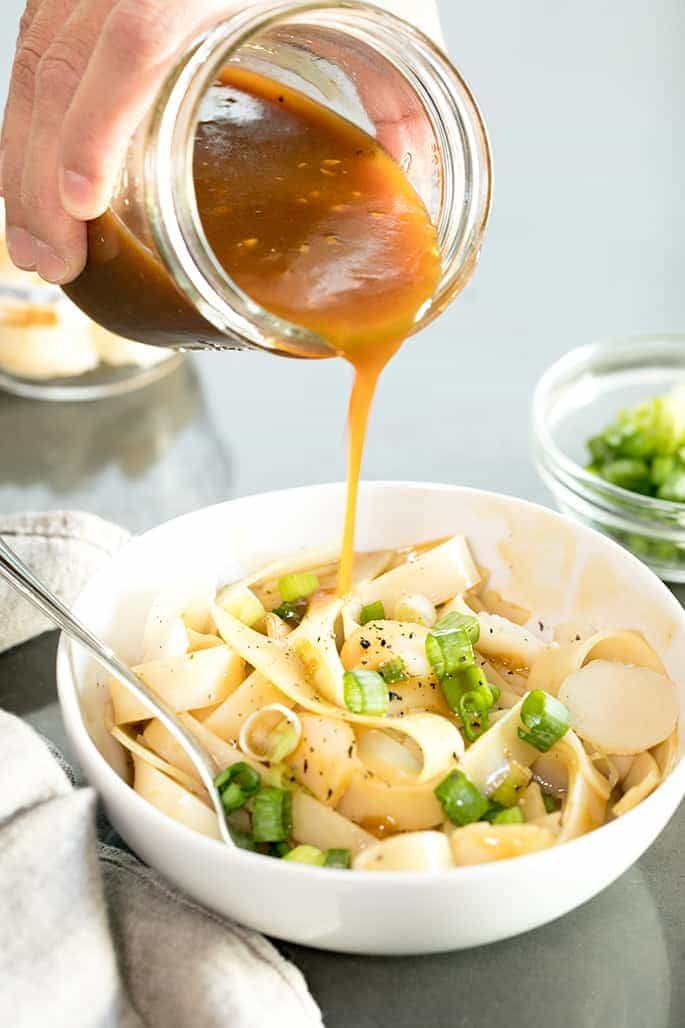How to make naturally gluten free lo mein with the perfect quick and easy sauce and your favorite long noodles. Add vegetables, chicken or nothing at all!