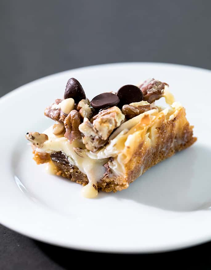 This recipe for 7 Layer Bars is endlessly customizable, made easily with or without coconut, gluten free graham cracker crumbs, and even easily made dairy free!