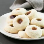 These easy jam thumbprint cookies are simple butter cookies made with flour, sugar, butter and egg yolks—and a dollop of jam on top. The best cookies are often the simplest ones!