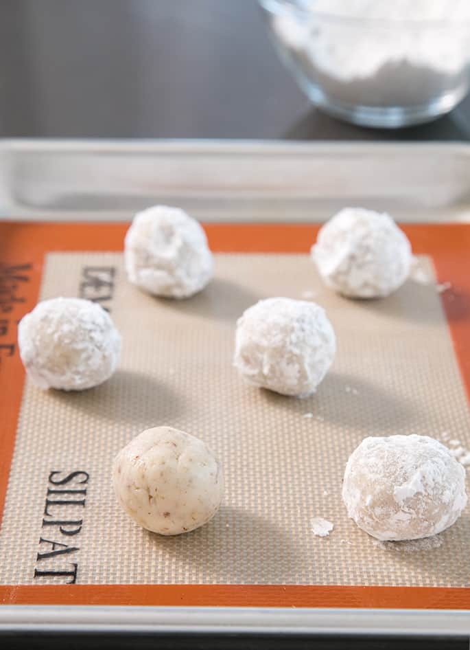 These gluten free snowball cookies, also known as Russian tea cakes and Mexican wedding cookies are super tender butter cookies, made with chopped nuts and always covered in powdered sugar.